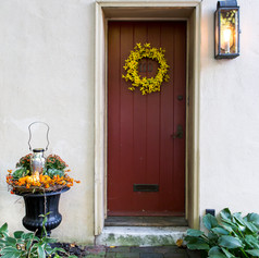 fall wreath and potted plants