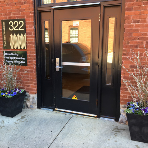 commercial spring container gardens - bloom storefront decor
