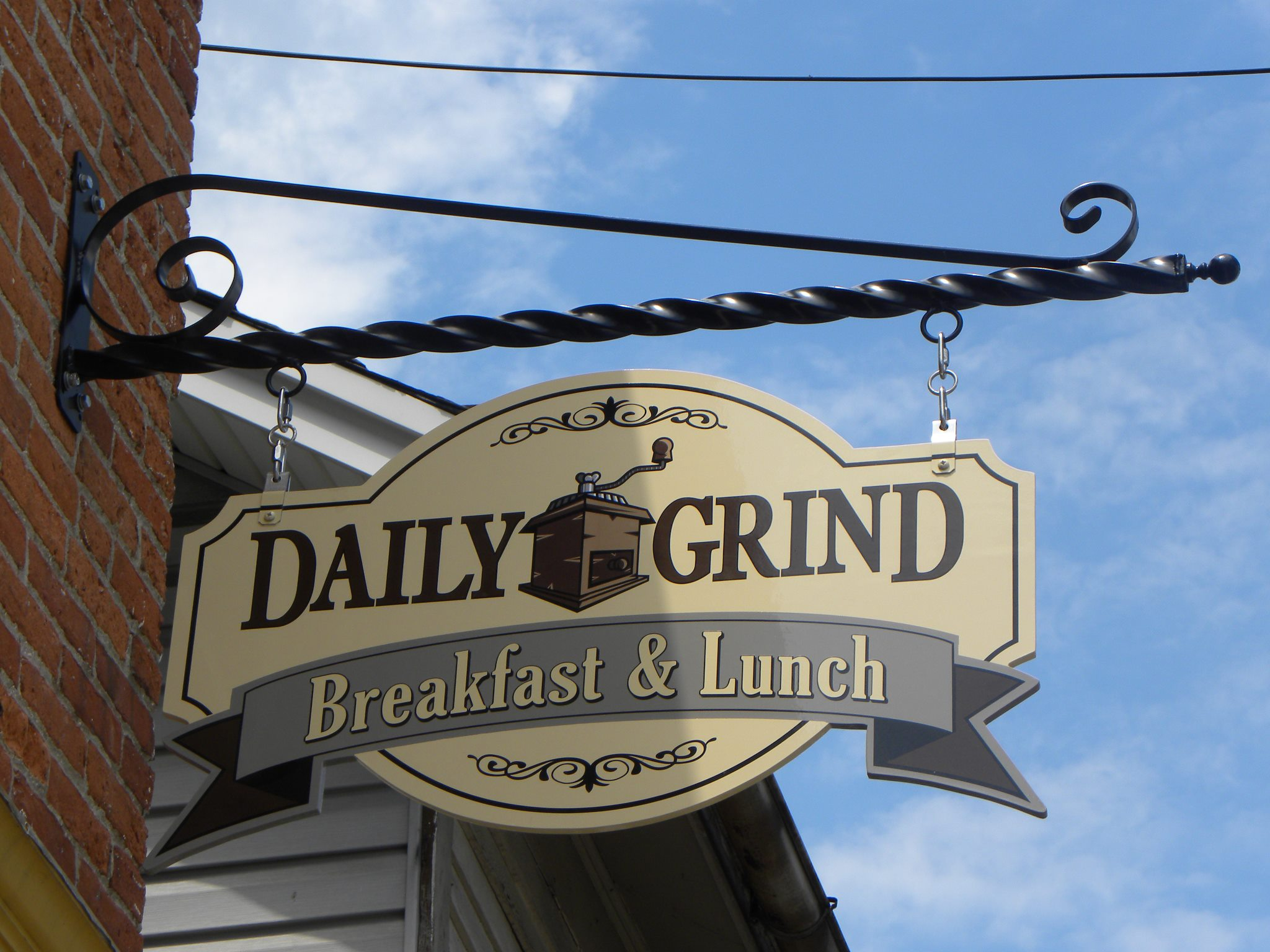 daily grind cafe sign bath