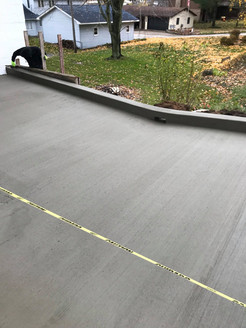 Fresh concrete driveway and curb