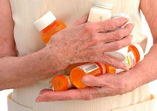 4-old_woman_holding_medication_bottles_j