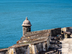 Custom Caribbean Vacation | GeoLuxe Travel | weathered building by the oceanuan