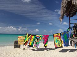 Custom Caribbean Vacation | GeoLuxe Travel LLC | towels drying on a beach