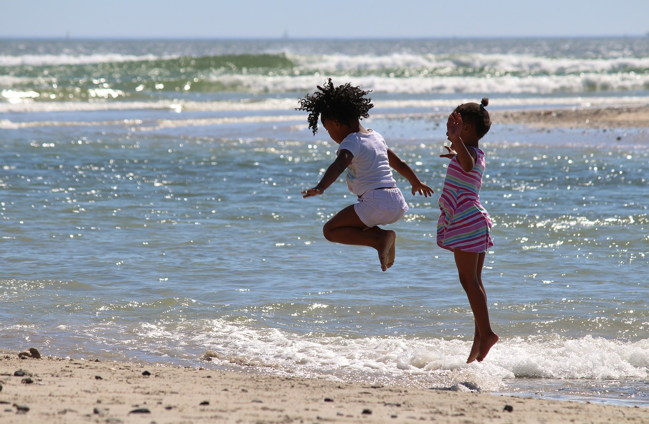 Africa Trip Planner | GeoLuxe Travel LLC | little girls playing in the ocean