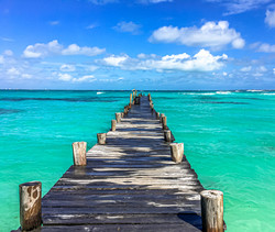 Custom Mexico Vacation | GeoLuxe Travel LLC | dock leading to the ocean