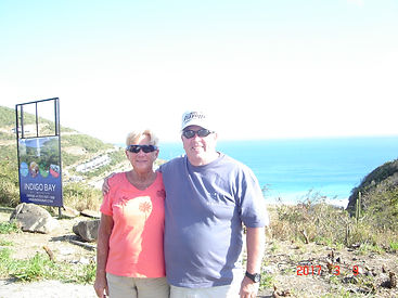 GeoLuxe Travel Testimonial | couple standing on a cliff by the ocean