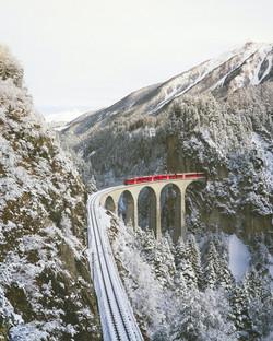 Europe Trip Planner | GeoLuxe Travel LLC | train bridge in the mountains