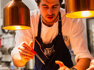 Custom Europe Vacation | GeoLuxe Travel | male chef preparing food