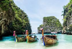 Custom Asia Vacation | GeoLuxe Travel LLC | boats on the ocean