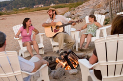 Custom Alaska and US Vacation   GeoLuxe Travel   man playing guitar to group of people