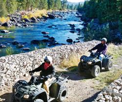 Custom Alaska and US Vacation   GeoLuxe Travel   four wheelers near a river