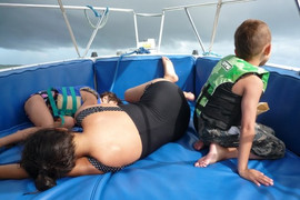 Lidia Louise & Marissa Marie sleeping as James Michael watches his Mom push back the storm clouds of the hurricane