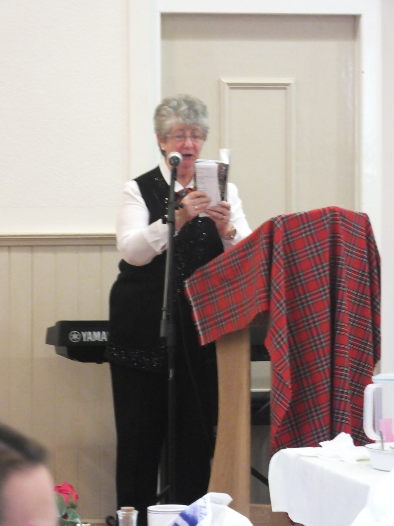 Anne reads from the Glasgow Bible