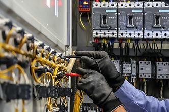 Electrical engineer using digital multi-