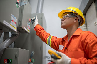 Electrician engineer checking electricity system in the box room energy building .jpg