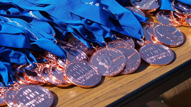 The Medal Mixer registration is now open!  December 14th @ Boone's Saloon.