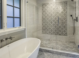 Master Bathroom with large tub and tiled