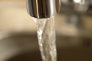 Close-up of running water from a faucet.