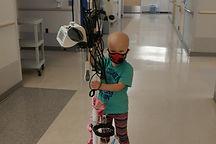 Leukemia Child Emma Noel with IV pole