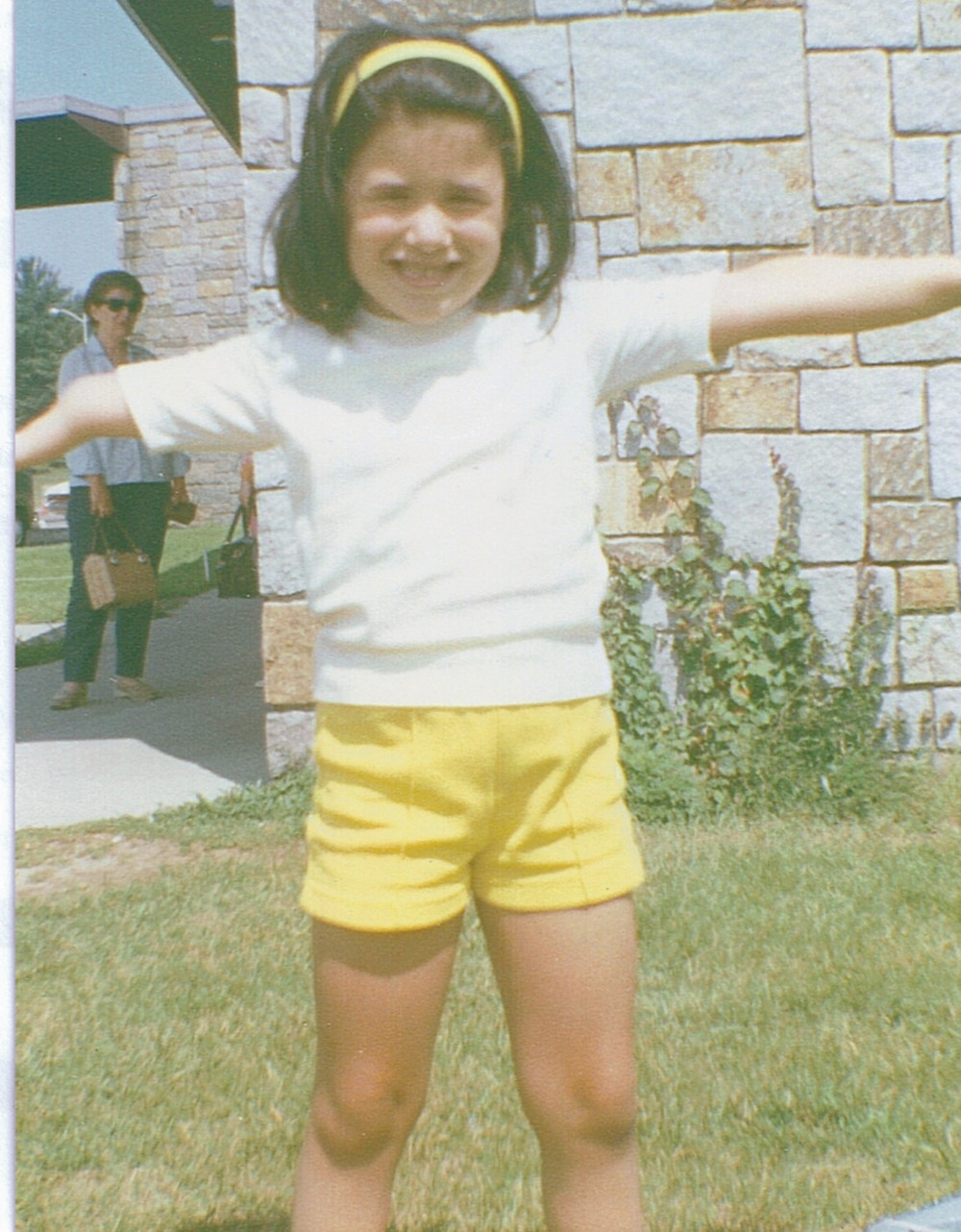 Angie as a young girl with Mom in the background
