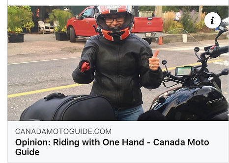One handed inspirational speaker Angie Sandow by her Honda motorcycle