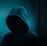 Shadowy hooded person representing cyber hacker.