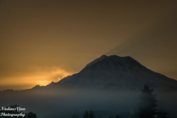 Sun behind Mt Rainier.jpg