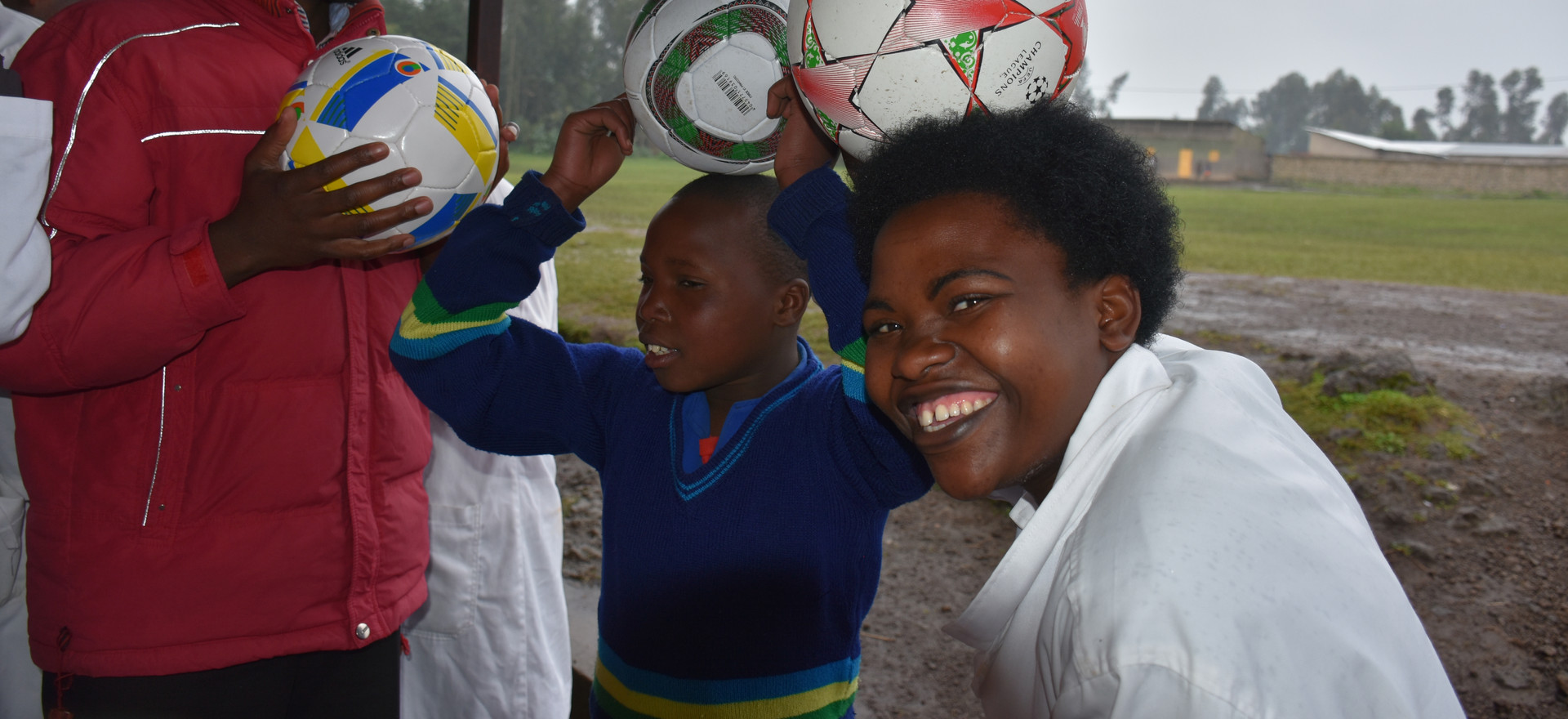 Rwanda  Bisate School teachers and kids and soccer balls