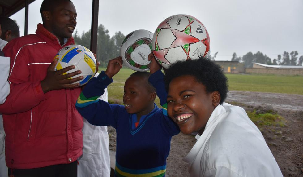 Rwanda  Bisate School teachers and kids and soccer balls
