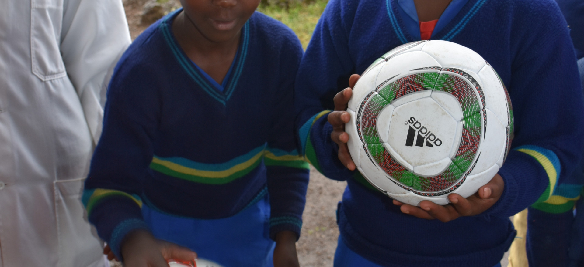 Rwanta Bisate School - children and their new soccer balls delivered by Henny's Kids