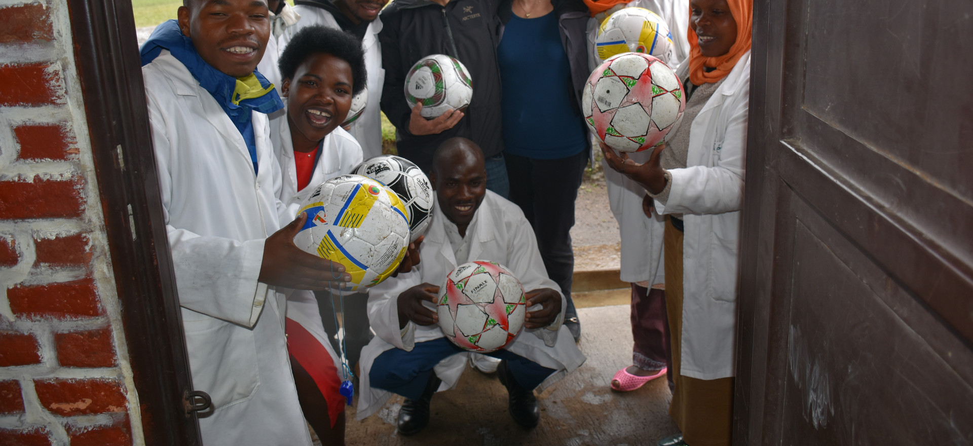 Rwanda - David Kempler/Candyce Stapen and Teachers delivering Soccer Balls