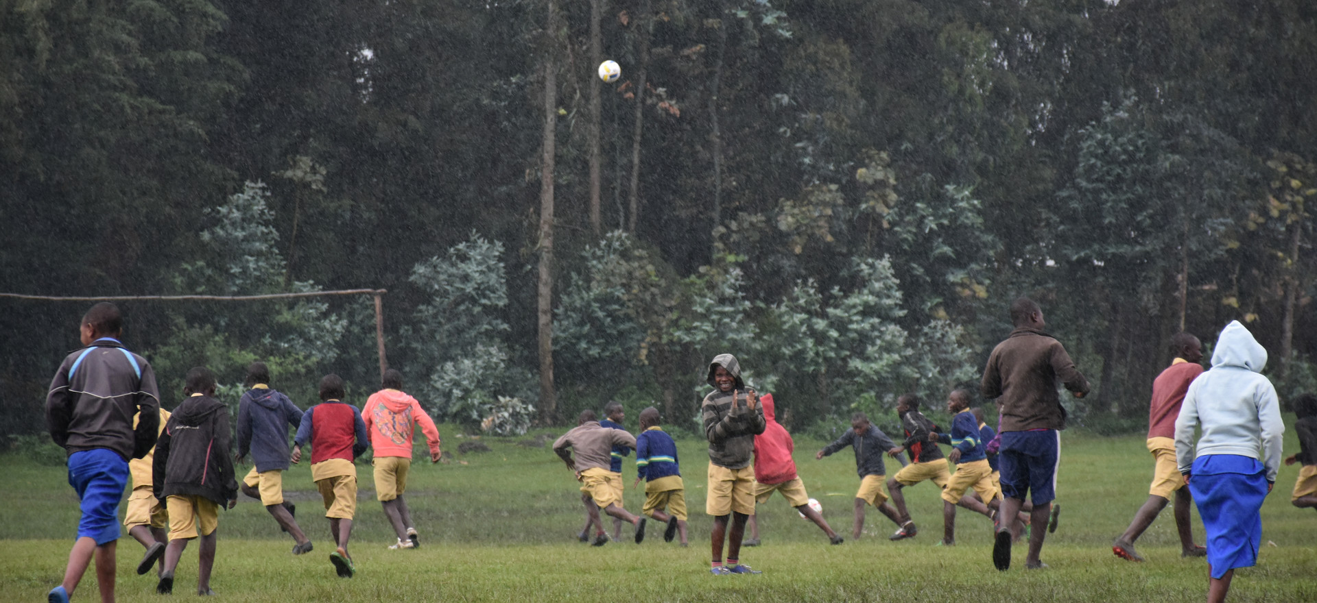 Rwanda Bisate School Playing Soccer in the Rain