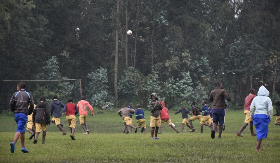 Rwanda Bisate School Playing Soccer in the Rain