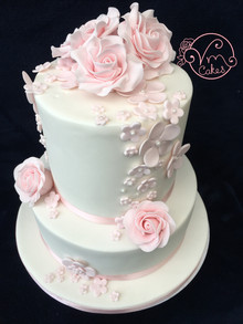 2-Tier white fondant wedding cake, fruit bottom tier w/ sugar roses