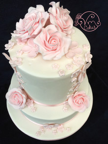2-Tier white fondant wedding cake, fruit bottom tier w/ sugar roses