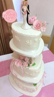 3-Tier pillar wedding cake, heart shape tiers with handmade edible flowers.