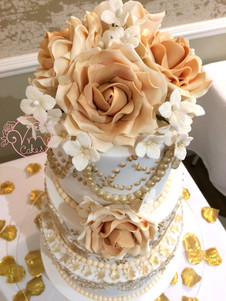 3-Tier with emboss and handmade edible Ombre roses.