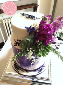 """2-Tier barrel wedding cake, 8"""" Vanilla with 10"""" cookies and cream w/ silver leaf and purple wash & floral decoration"""