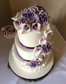 3-tier fondant w\ Calla Lilly and Rose cascade. vertical ruffles w/purple ribbon
