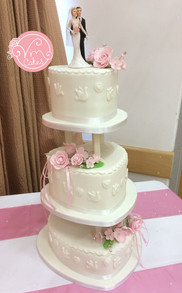3-Tier pillar wedding cake, heart shape tiers with handmade edible flowers.