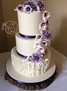 3-tier fondant w\ Calla Lilly and Rose cascade. vertical ruffles w/purple ribbon