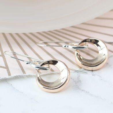 Rose gold crescent hoop earings on silver plated hooks