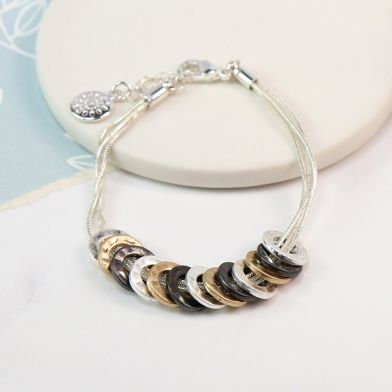 Mixed finish multi hoop triple strand bracelet