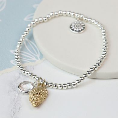 Silver plated bracelet with gold shell and crystal