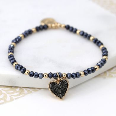 Black and golden bead bracelet with heart charm