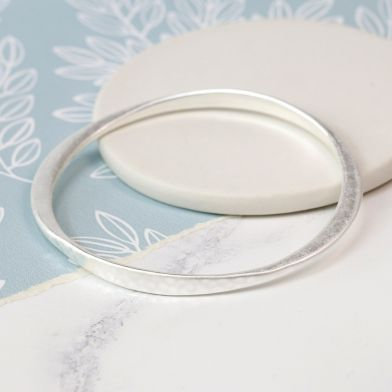Silver plated worn finish tapered bangle