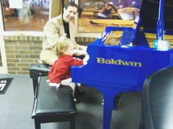 Dean Malsack and little friend on the blue in the Piano Trends Showroom