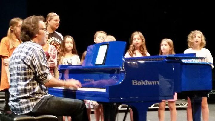 Kurt and local Encore childrens choir rehearsing for tomorrow night show at Raue