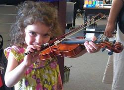 violin girl at store