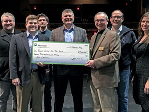 Nicor Presents Check to Raue Center